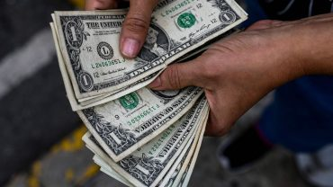 the-tell:-the-'dollar-smile':-the-us.-currency-does-well-when-the-stock-market-either-jumps-or-slumps